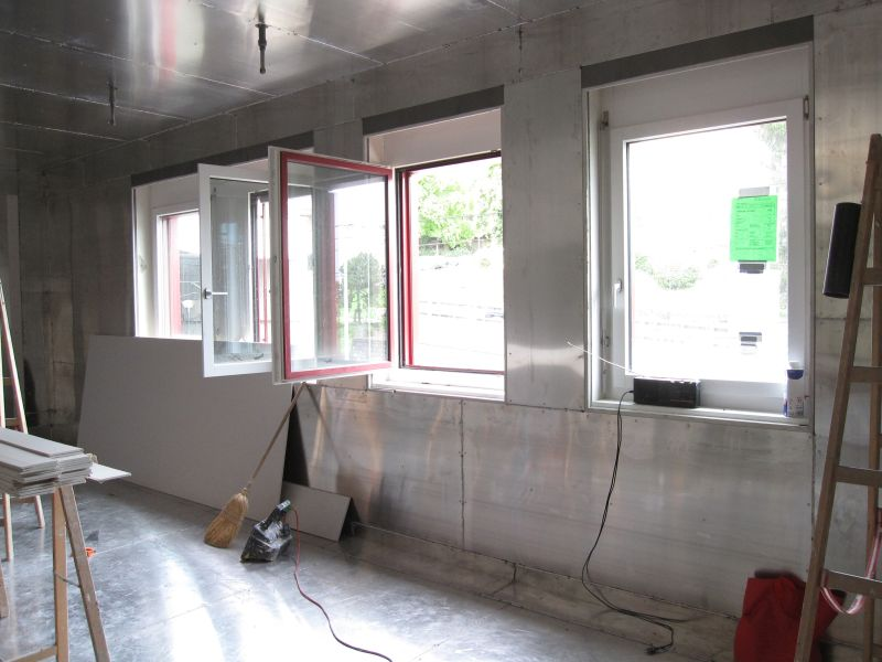 Magnetic shielding plates on wall, floor ceiling and around windows inside office building.