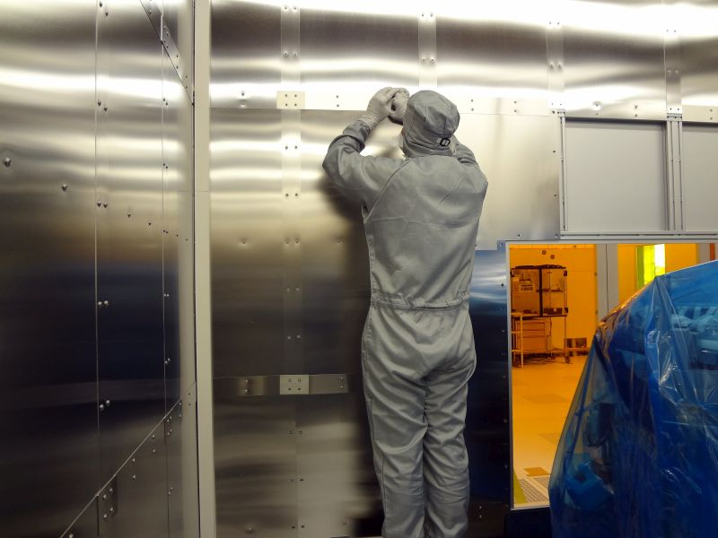 Installation of magnetic shielding panels inside the tool room.